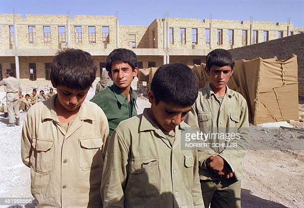 Captured Iranian youths POW aged 14 pose while under guard on IraqIran border 20 June 1988 during IraqIran war They were among some reported 1500 POW...