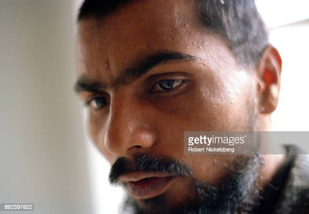 A captured Pakistani Taliban fighter from Punjab province answers questions about his recruitment November 30 2001 near the summer palace of Prince...