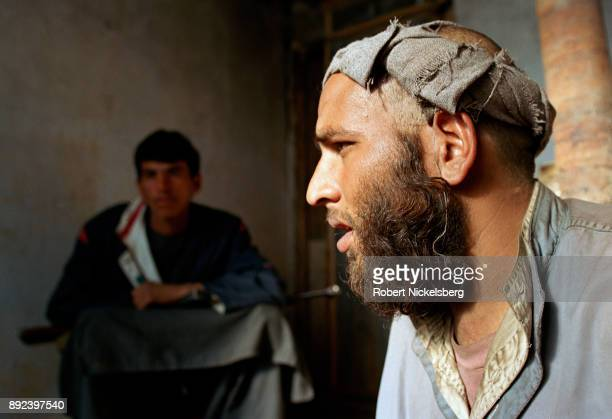 A captured Pakistani Taliban fighter speaks to a reporter in a holding cell November 30 2001 near the summer palace of Prince Mohammad Daud southwest...