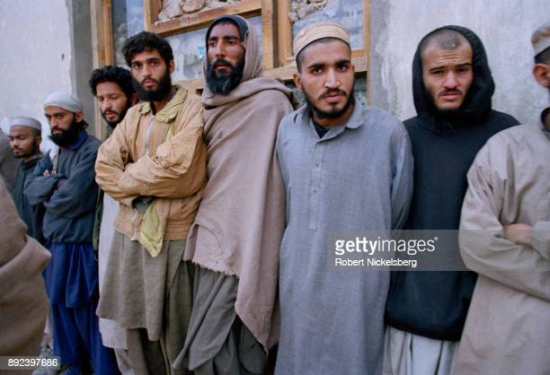 Captured Pakistani Taliban fighters stand outside their holding cell November 30 2001 near the summer palace of Prince Mohammad Daud southwest of...