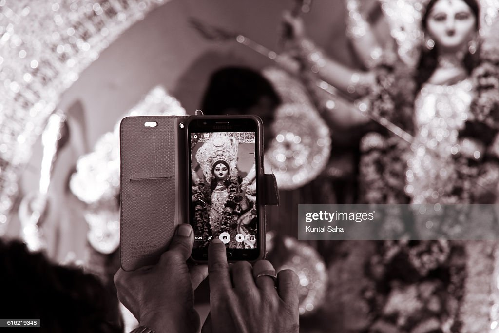 Capturing goddess durga in mobile : Stock Photo