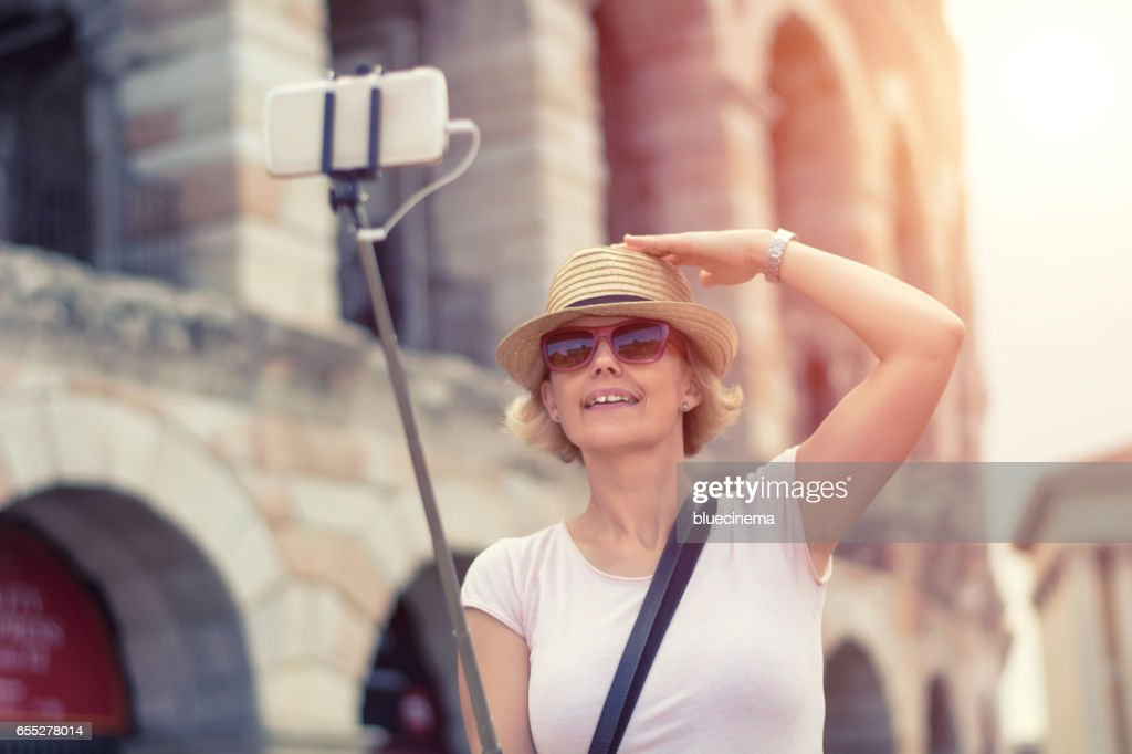 Capturing her travel experience : Stock Photo