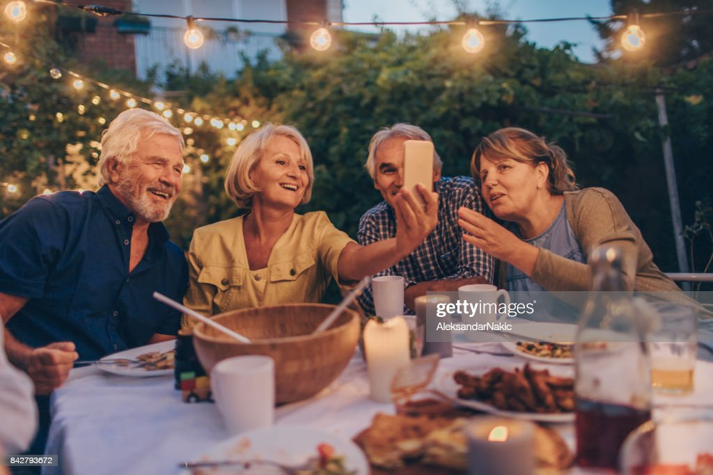 Capturing memories from dinner party : Stock Photo