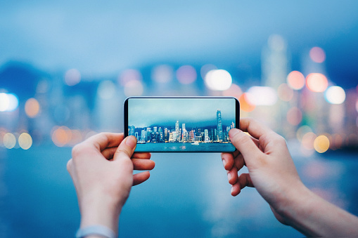 Capturing the iconic city skyline of Hong Kong by the Victoria Harbour during sunset - gettyimageskorea