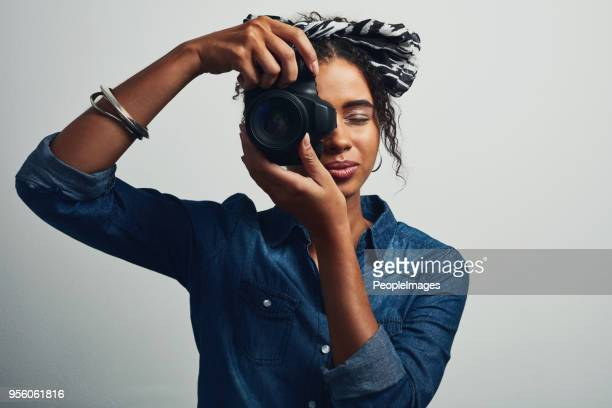 capturing what's new with her camera - digital camera stock pictures, royalty-free photos & images