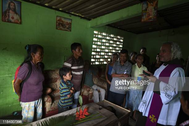 Capuchin friar Nelson conducts a Catholic ceremony for a Yukpa native who died due to a gastric ulcer at his house near Los Angeles del Tukuko...