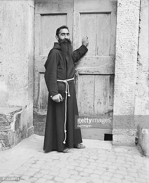 Capuchin monk stands at doorway of church