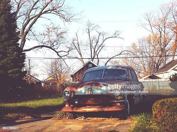 Car Abandoned On Backyard Of Country House