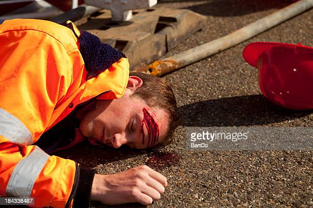 car accident and road construction. injured person on asphalt. - gory car accident photos stock pictures, royalty-free photos & images