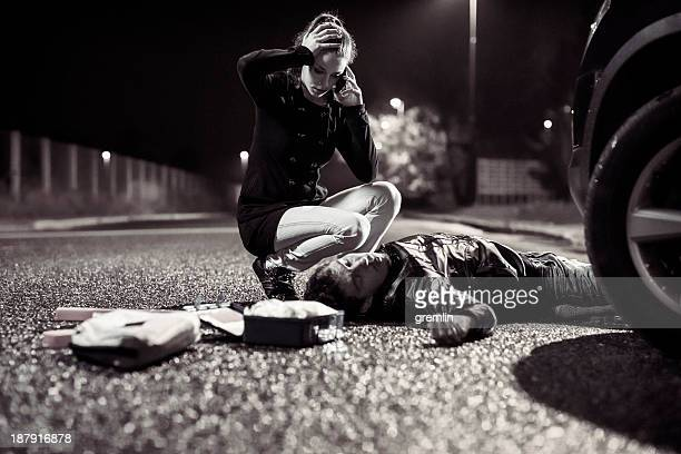 car accident and woman on the phone - dead bodies in car accident photos stock pictures, royalty-free photos & images