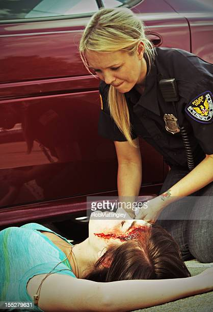 car accident fatality - female corpse stock photos and pictures