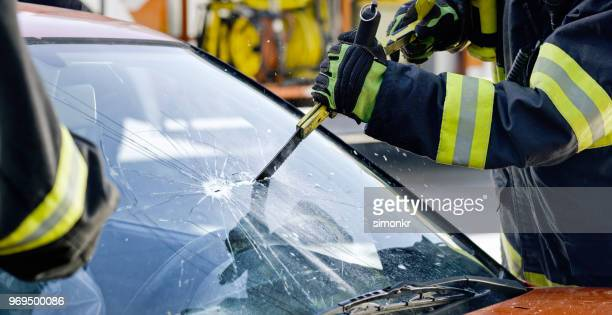 car accident - glass cutter stock photos and pictures