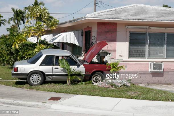 A car accident which hit the wall on the corner of a house in Little Havana