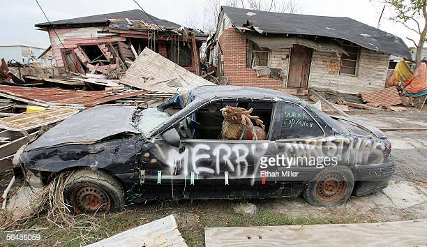 """Car adorned with a toy reindeer, Christmas lights and a spray-painted """"Merry Christmas"""" message is seen in the heavily damaged Lower Ninth Ward..."""