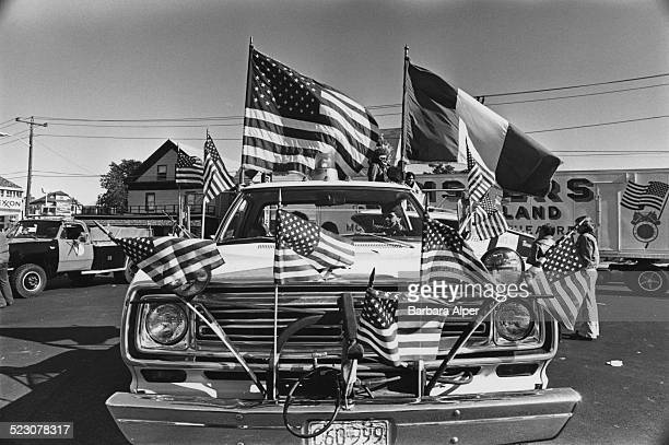 A car adorned with American and Italian flags at the Columbus Day Parade in Medford Massachusetts USA 9th October 1978