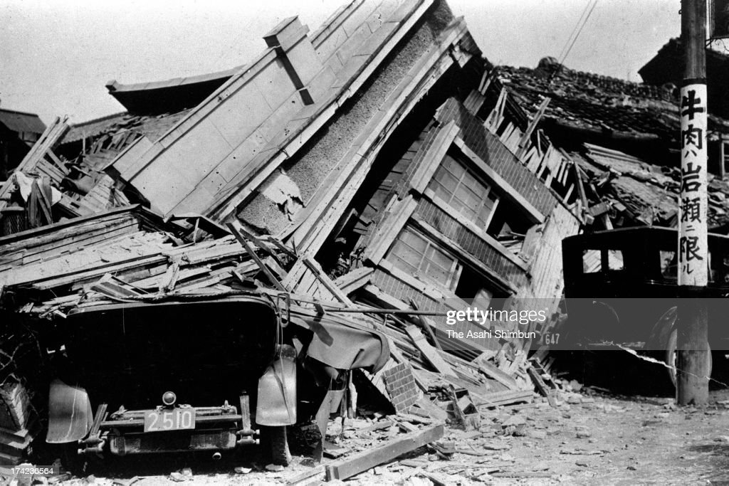 A car and a house are squashed by the Great Kanto Earthquake in September 1923 in Tokyo, Japan. The estimated Magnitude 7.9 strong earthquake hit Japan's capital Tokyo and surrounding area, the death toll was estimated up to 105,000 people. Approximately 38,000 victims were killed by fire whirl engulfed the former Army Clothing Depot site, where people had evacuated.