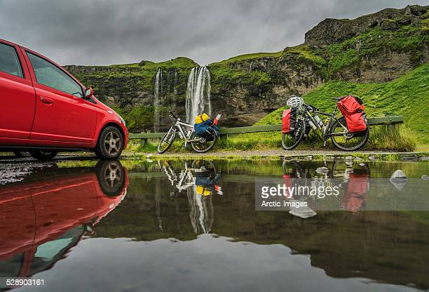 Car and bicycles by Seljalandsfoss, Iceland
