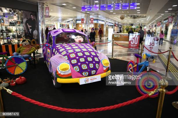 A car and bicycles covered with wool are seen during the Woolen Tales exhibition at Migros Shopping Mall in Antalya Turkey on January 17 2018...