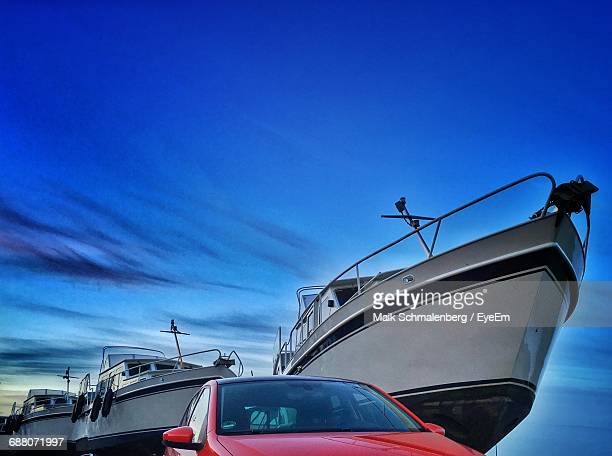 Car And Boats Against Sky