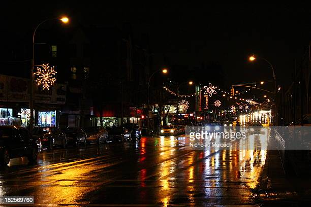 CONTENT] Car and city lights reflect in the rain water in Sunnyside Queens New York City