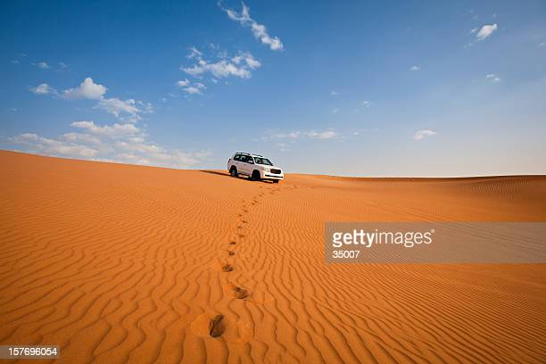 4WD car and footprints in the desert