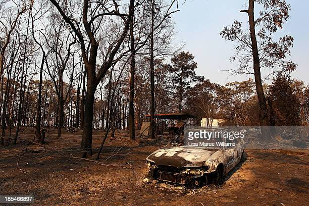 A car and home destroyed by bushfire as seen on October 21 2013 in Yellow Rock Australia One man has died and hundreds of properties have been...