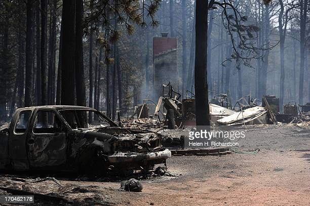 A car and house are completely destroyed from the Black Forest on June 12 2013 The Black Forest fire continues to burn and has yet to have any...