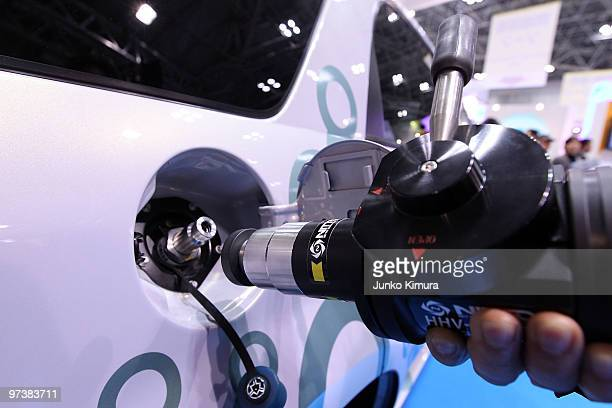 FC car and its charger are displayed during the 6th International Hydrogen Fuel Cell Expo at Tokyo Big Sight on March 3 2010 in Tokyo Japan Clean...