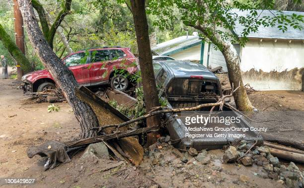 Car and pickup truck were washed down a creek in Silverado Canyon in Silverado following heavy rain early on Wednesday morning, March 10. 2021. The...