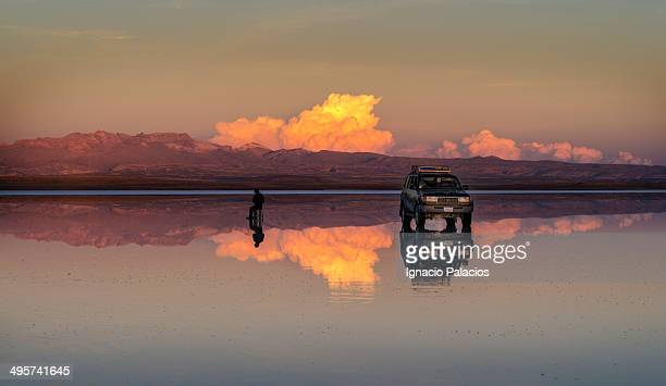 4WD Car and reflections in El Salar de Uyuni