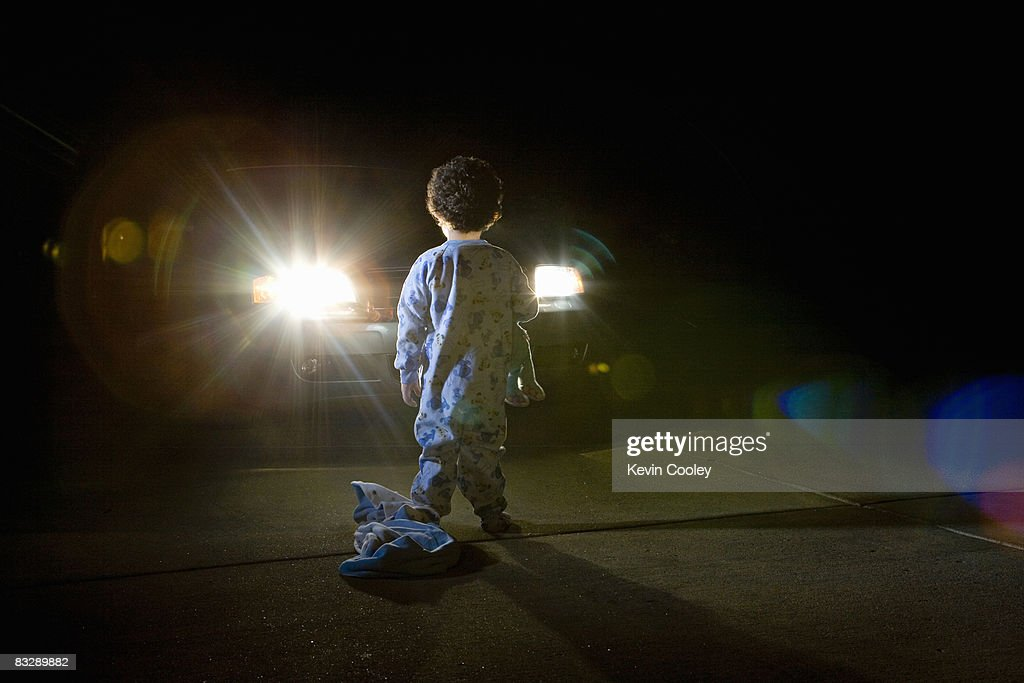 Car And Toddler In Driveway Night Stock Photo Getty Images