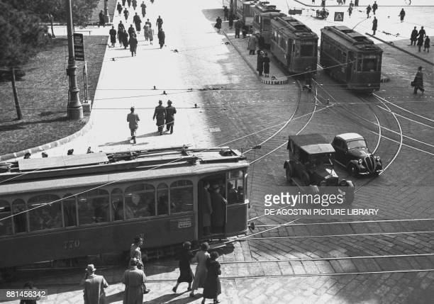 Car and tram at a crossroad March 15 Genoa Italy 20th century