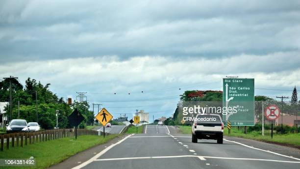car and truck traffic on the highway. - crmacedonio stock photos and pictures