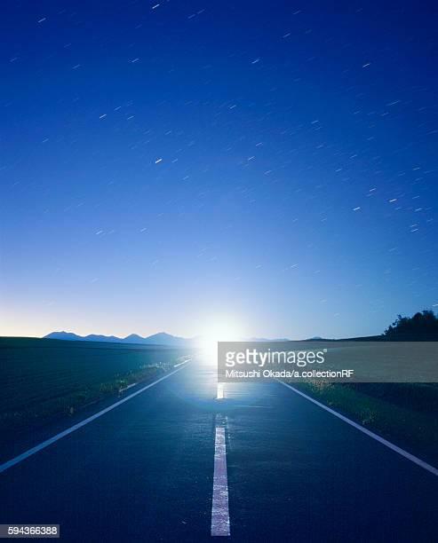 Car approaching on motorway at night