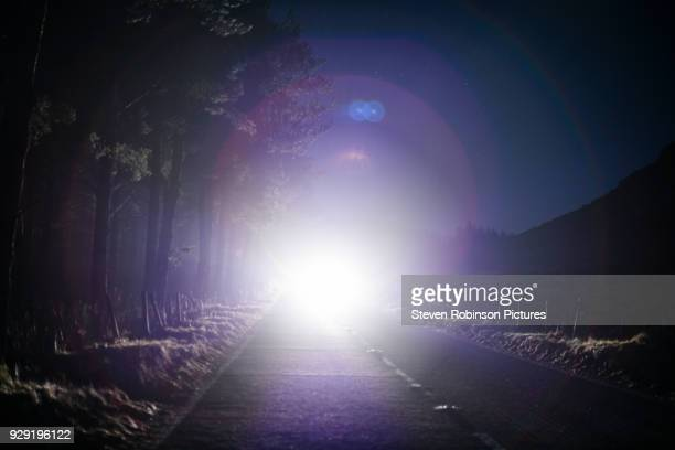 car approaching - headlight stock pictures, royalty-free photos & images