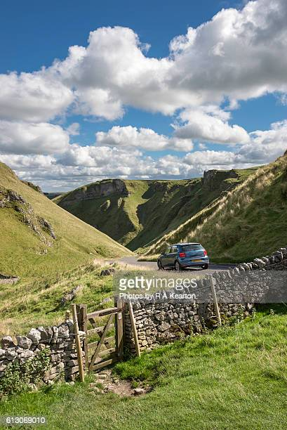 Car approaching Winnats Pass in the Peak District, England
