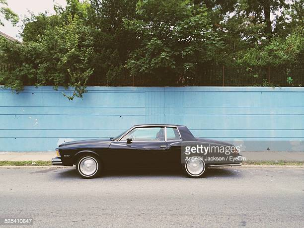 car at roadside - side view stock pictures, royalty-free photos & images