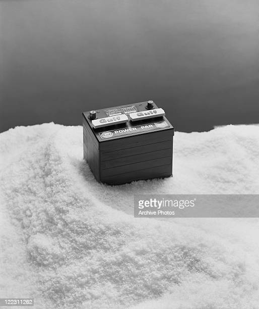 Car battery on snow, close-up