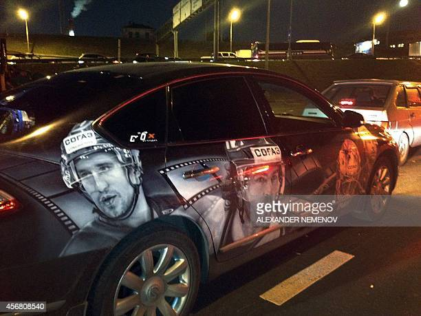 A car bearing portraits of late Russian ice hockey player Alexander Galimov Czech legend Jaromir Jagr who also played in Avangard Omsk of Russia's...