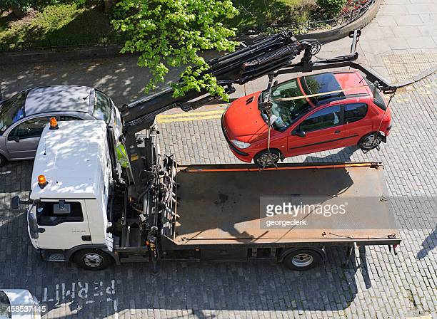 Car Being Lifted Following Parking Offense