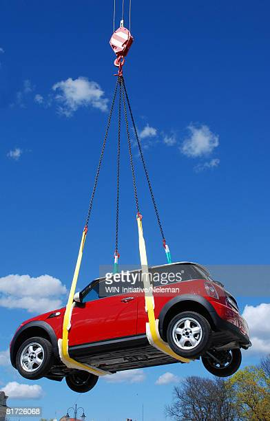 Car being lifted, low angle view