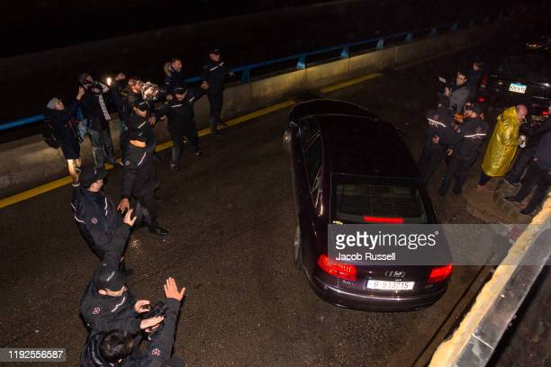 A car believed to be carrying former chairman of Nissan and Mitsubishi Motors Carlos Ghosn leaves a carpark of the Press Syndicate Building after his...