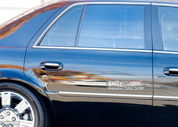 A car believed to be carrying former Director of the Central Intelligence Agency David Petraeus leaves a secure parking garage after a closed hearing...