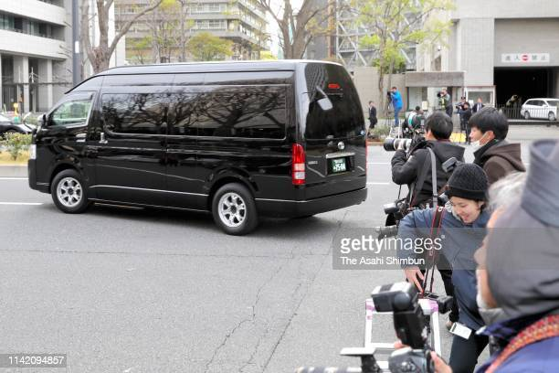 A car believed to carry Carole Ghosn wife of former Nissan Motor CEO Carlos Ghosn leaves the Tokyo District Court after being questioned from...