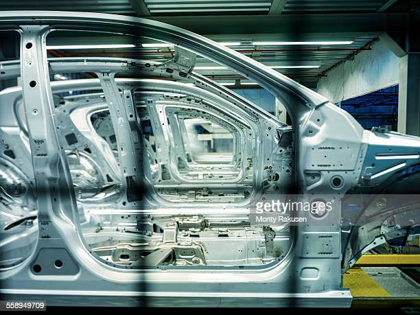 Car bodies on production line in car factory, close up