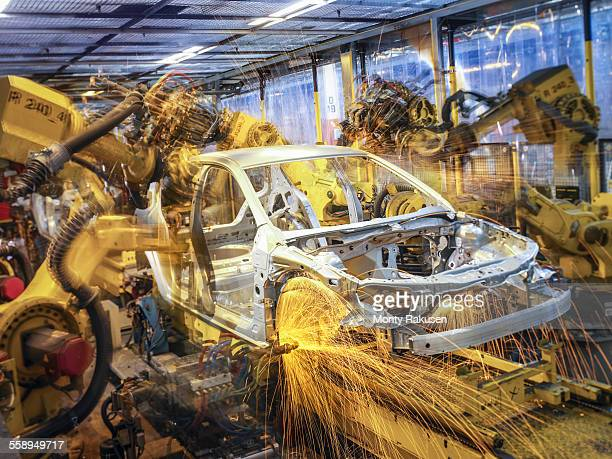 Car body being welded on production line in car factory
