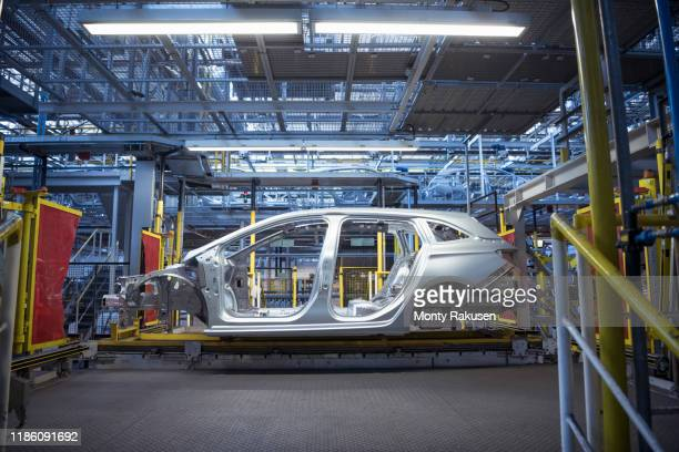 car body on production line in car factory - no people stock pictures, royalty-free photos & images