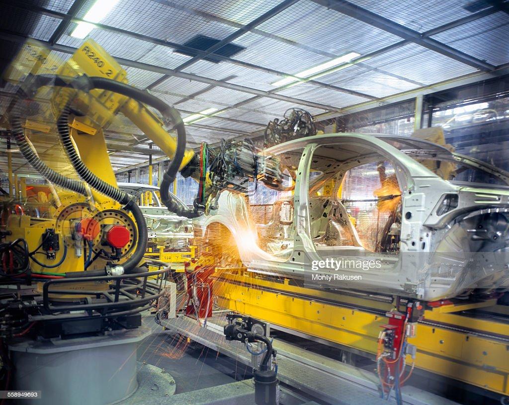 Car body welding robots in car factory : Stock Photo