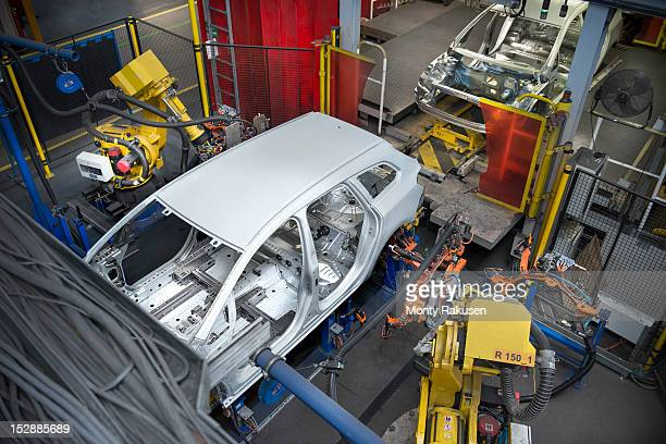 Car body with robots on production line in car factory