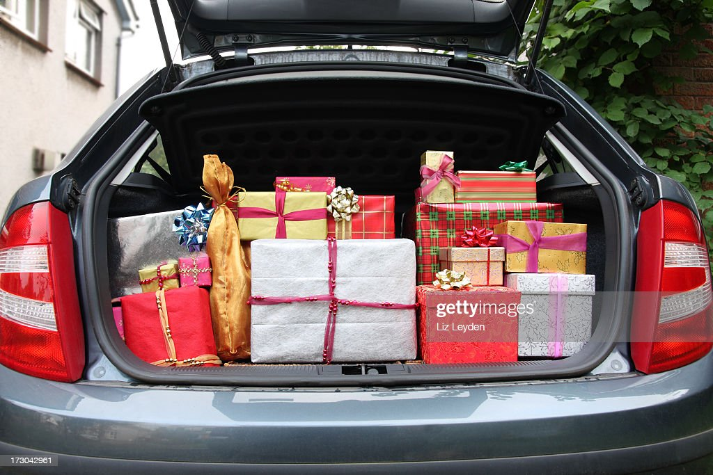 Car boot filled with Christmas presents : Stock Photo